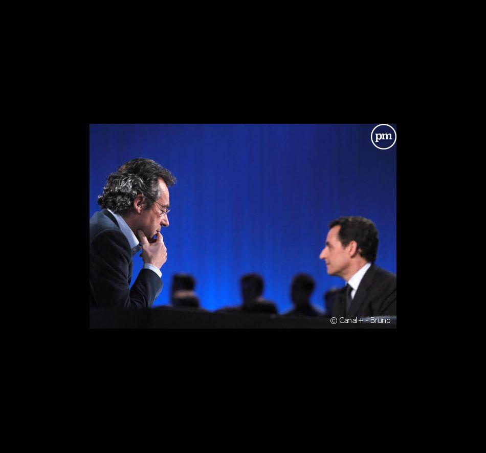 """Michel Denisot et Nicolas Sarkozy sur le plateau du """"Grand journal de Canal+"""" (1er mars 2006)"""