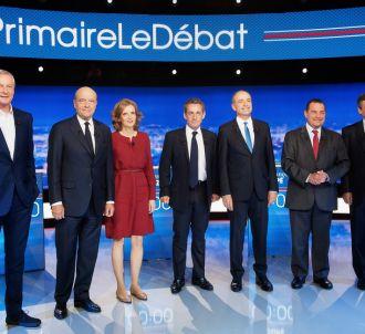Les sept candidats lors du premier débat