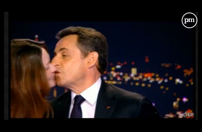 Le baiser de Carla-Bruni Sarkozy sur le plateau de TF1, mercredi soir.