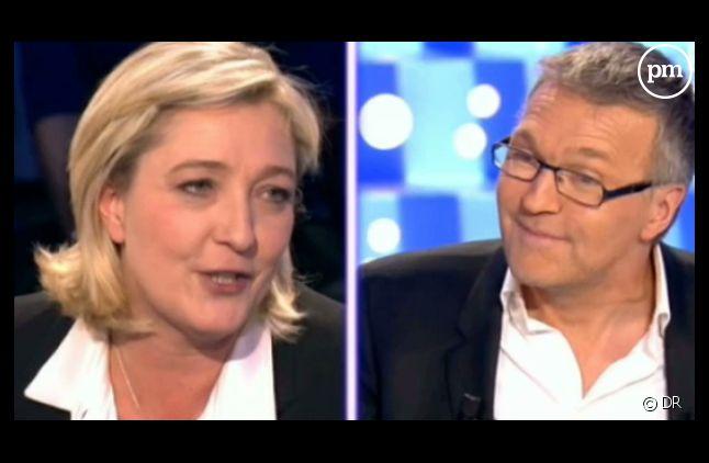 """Marine Le Pen et Laurent Ruquier, sur le plateau de """"On n'est pas couché""""."""