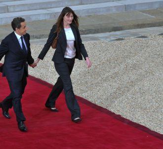 Carla Bruni-Sarkozy et l'ex-Chef de l'Etat, lors de leur...