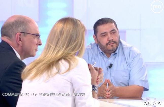 Un homme politique refuse de regarder une journaliste à la télé belge.