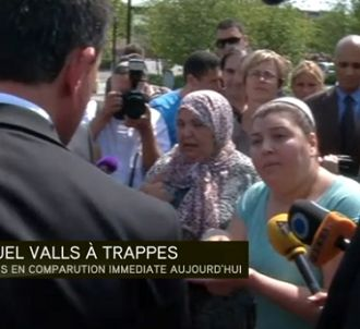 Manuel Valls face à une habitante de Trappes
