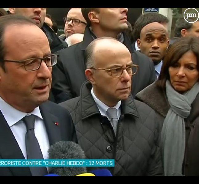 """François Hollande au siège de """"Charlie Hebdo"""", le 7 janvier 2015."""