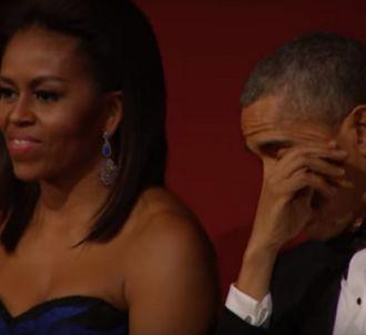 Barack Obama ému devant Aretha Franklin.