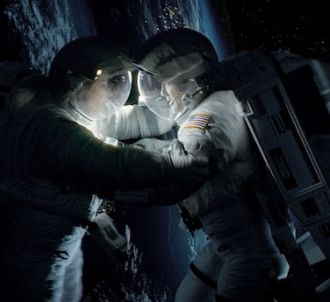 Sandra Bullock et George Clooney dans 'Gravity' d'Alfonso...