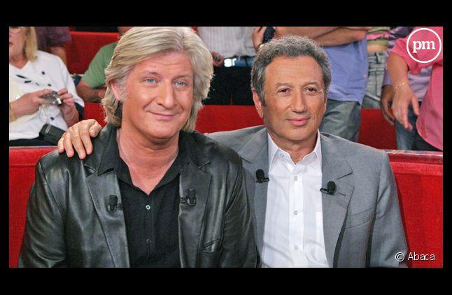 Michel Drucker et Patrick Sébastien, en 2005.